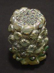 Blown glass: Small reduction paperweights, optic molded and snipped with shears, then melted down to round off the piece.