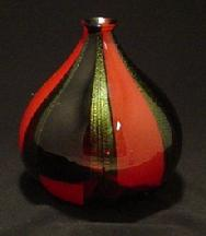 This vase is made of red & black sheet glass and golden dichroic strips, approximately 12""