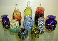Blown Glass Perfume bottles were produced with varied color techniques: reduction, millifiores, frits, and threads.  All perfume bottles come with stoppers.
