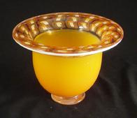 Blown Glass: Footed Orange Incalmo Bowl was footed orange with millifiores and a white lip wrap. This bowl measures approximately 10""