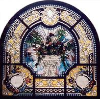 "The intricate design in ""Beveled Bouquet"" contains many wheel-cut bevels.  Approximately 7 1/2' X 7 1/2'.  Two rows of antique jewels grace its inside and outside borders. A lovely floral bouquet in a beveled vase."