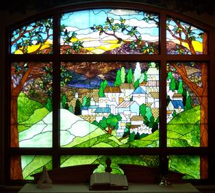 """The Village"" is an original stained glass panel which now resides in a hospital chapel window in Florida."