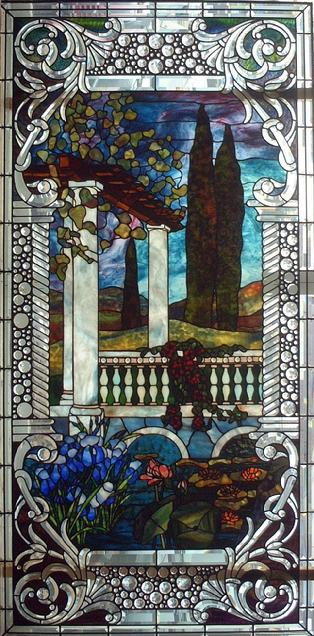 The design in this window is based off of a Tiffany window. A special feature about this design is that there is triple plating over the water to add depth. This window measures approximately 3'x6'