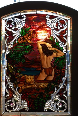 Aziza, the powerful and beloved jungle maiden, is depicted in this stained glass and bevelled work by Bogenrief Studios of Sutherland, Iowa.