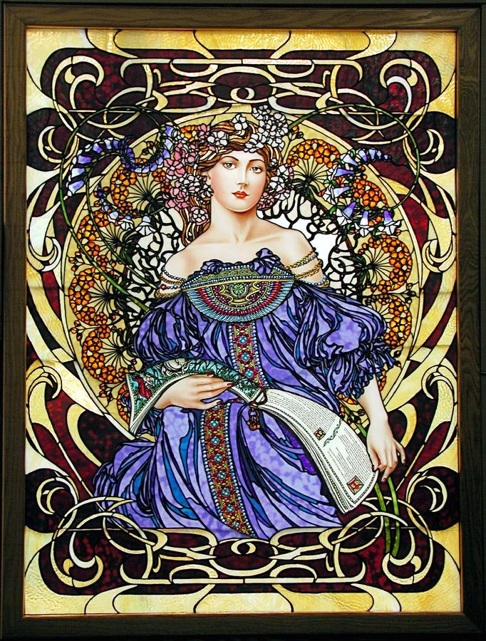 """DayDream"" was inspired by Alphonse Mucha's work.  The lady pauses from reading Geoffrey Chaucer's ""The Knight in Shining Armor"" long enough to imagine herself in those times.  Sprays of flowers encircle her.  Each petal of each flower is hand selected to achieve color variation.  Ring mottled glass was used in the flower petals."